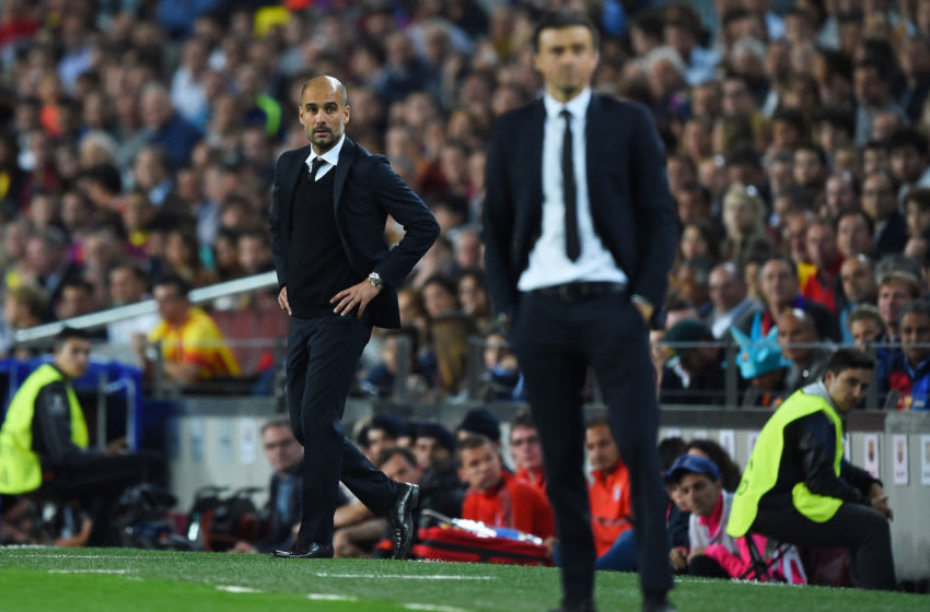 Josep Guardiola the head coach of Bayern Muenchen looks on past Luis Enrique the head coach of Barcelona. (Photo by Shaun Botterill/Getty Images)