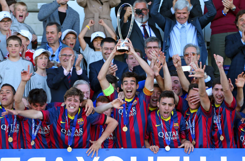 Captain Roger Riera of FC Barcelona (C) holds the Lennart Johansson trophy after winning the UEFA Youth League Final match between Benfica Lisbon and FC Barcelona at Colovray Stadion on April 14, 2014. (Photo by Philipp Schmidli/Getty Images)