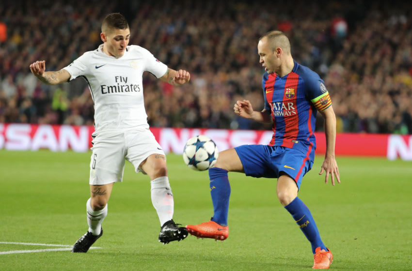 Marco Verratti of Paris Saint-Germain in action with Andres Iniesta. (Photo by Xavier Laine/Getty Images)