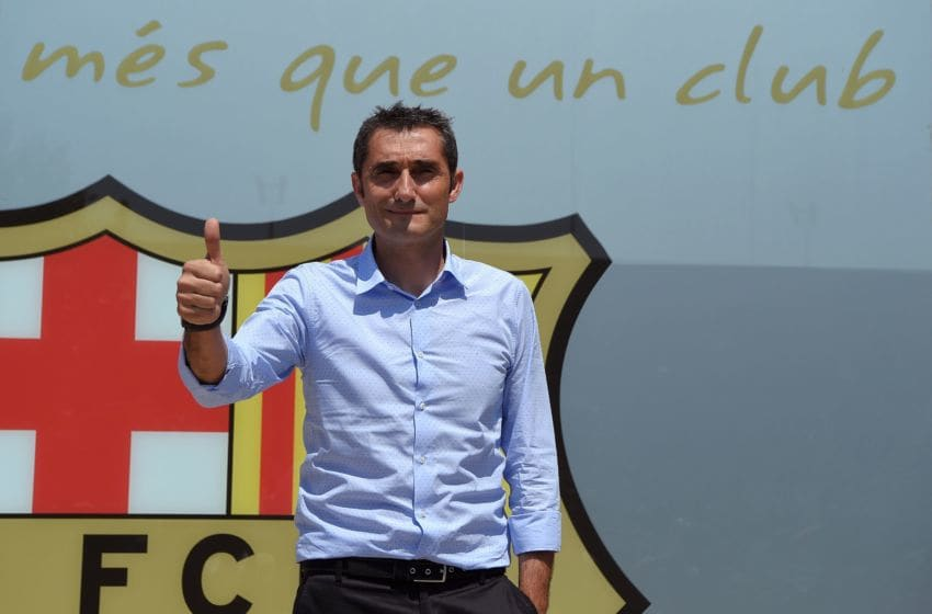 Barcelona's new coach Ernesto Valverde gives the thumbs up as he poses outside the Camp Nou stadium in Barcelona on May 31, 2017 prior to signing his new contract with the Catalan club. / AFP PHOTO / LLUIS GENE (Photo credit should read LLUIS GENE/AFP/Getty Images)