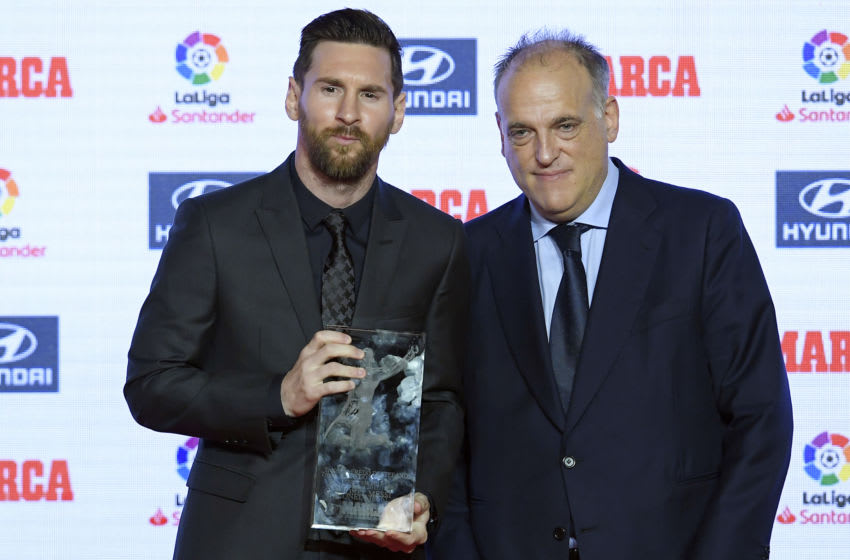 Barcelona's Argentinian forward Lionel Messi (L) poses with the president of La Liga, Javier Tebas. (Photo credit LLUIS GENE/AFP via Getty Images)