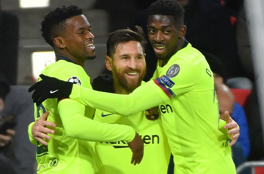 Barcelona's Argentine forward Lionel Messi (C) celebrates with teammates French forward Ousmane Dembele (R) and Portuguese defender Nelson Semedo (L) (Photo by EMMANUEL DUNAND / AFP via Getty Images)