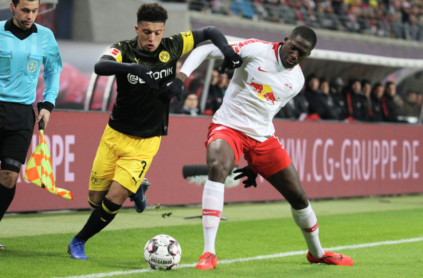 LEIPZIG, GERMANY - JANUARY 19: Dayot Upamecano of Leipzig challenges Jadon Sancho of Dortmund during the first Bundesliga match between RB Leipzig and Borussia Dortmund at Red Bull Arena on January 19, 2019 in Leipzig, Germany. (Photo by Karina Hessland-Wissel/Bongarts/Getty Images)