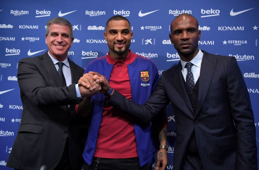 Barcelona's new Ghanaian forward Kevin-Prince Boateng poses with Barcelona's French technical secretary Eric Abidal (R) and Barcelona's Spanish vice president Jordi Mestre (L) during his official presentation at the Camp Nou stadium in Barcelona on January 22, 2019. - Boateng has vowed to make the most of his shock arrival at Barcelona, after a loan move for the journeyman from Italian side Sassuolo was sealed. (Photo by LLUIS GENE / AFP) (Photo credit should read LLUIS GENE/AFP via Getty Images)