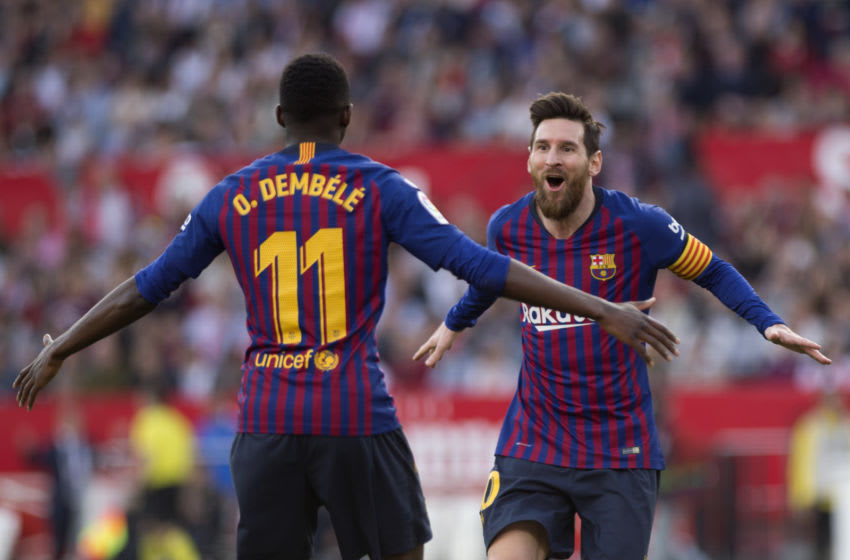 Barcelona's Argentinian forward Lionel Messi (R) celebrates with Barcelona's French forward Ousmane Dembele (Photo by JORGE GUERRERO / AFP) (Photo credit should read JORGE GUERRERO/AFP via Getty Images)