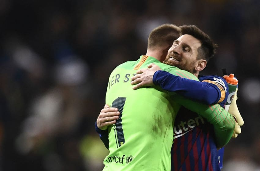 Barcelona's Argentinian forward Lionel Messi celebrates their win with Barcelona's German goalkeeper Marc-Andre Ter Stegen at the end of the Spanish Copa del Rey (King's Cup) semi-final second leg football match between Real Madrid and Barcelona at the Santiago Bernabeu stadium in Madrid on February 27, 2019. (Photo by OSCAR DEL POZO / AFP) (Photo credit should read OSCAR DEL POZO/AFP via Getty Images)