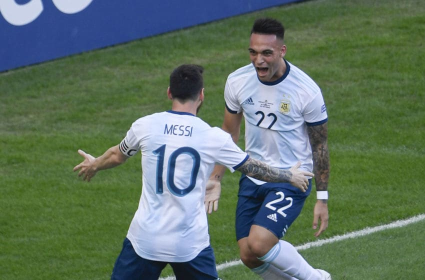 Argentina's Lautaro Martinez (R) celebrates with teammate and Barcelona captain Lionel Messi (Photo credit MAURO PIMENTEL/AFP via Getty Images)