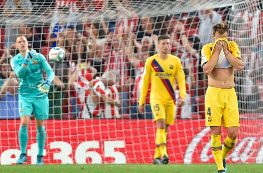 Barcelona's Croatian midfielder Ivan Rakitic (R) reacts to Athletic's goal during the Spanish league football match between Athletic Club Bilbao and FC Barcelona at the San Mames stadium in Bilbao on August 16, 2019. (Photo by ANDER GILLENEA / AFP) (Photo credit should read ANDER GILLENEA/AFP/Getty Images)