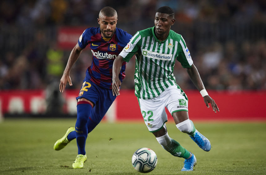 Rafinha of FC Barcelona competes for the ball with Emerson of Real Betis. (Photo by Quality Sport Images/Getty Images)