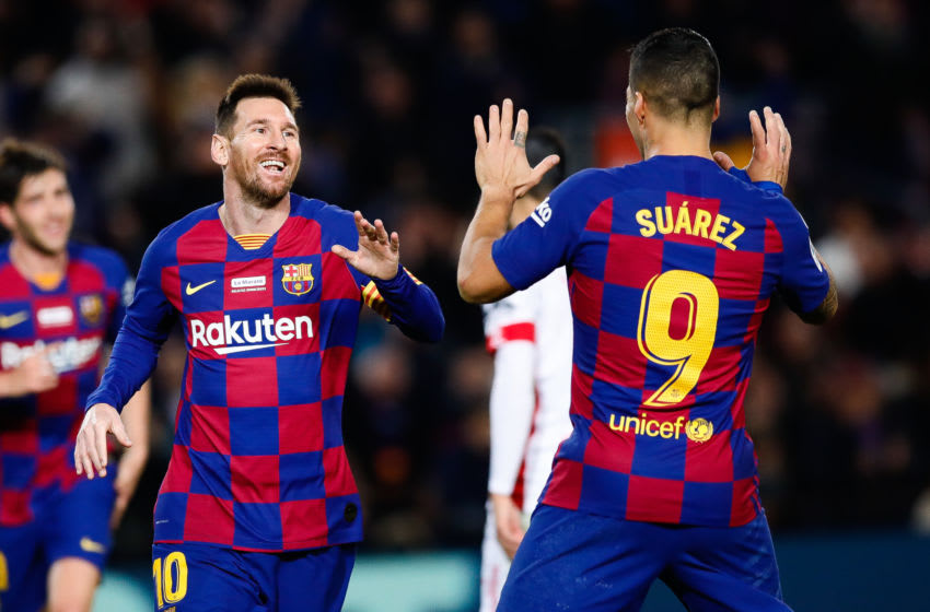 BARCELONA, SPAIN - DECEMBER 07: Lionel Messi of FC Barcelona celebrates with Luis Suarez of FC Barcelona the 5-2 during the Liga match between FC Barcelona and RCD Mallorca at Camp Nou on December 07, 2019 in Barcelona, Spain. (Photo by Eric Alonso/MB Media/Getty Images)