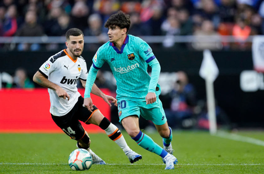 (L-R) Jose Gaya of Valencia CF, Alex Collado of FC Barcelona. (Photo by Jeroen Meuwsen/Soccrates/Getty Images)