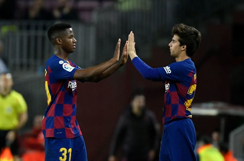 Ansu Fati (L) and Riqui Puig (R), FC Barcelona. (Photo by LLUIS GENE/AFP via Getty Images)