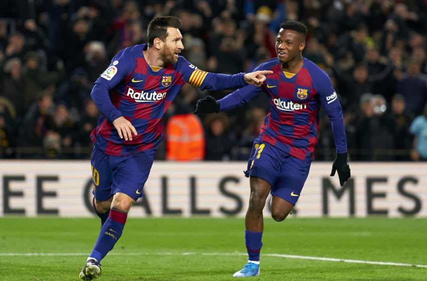 Lionel Messi of Barcelona with his teammate Ansu Fati (Photo by Quality Sport Images/Getty Images)