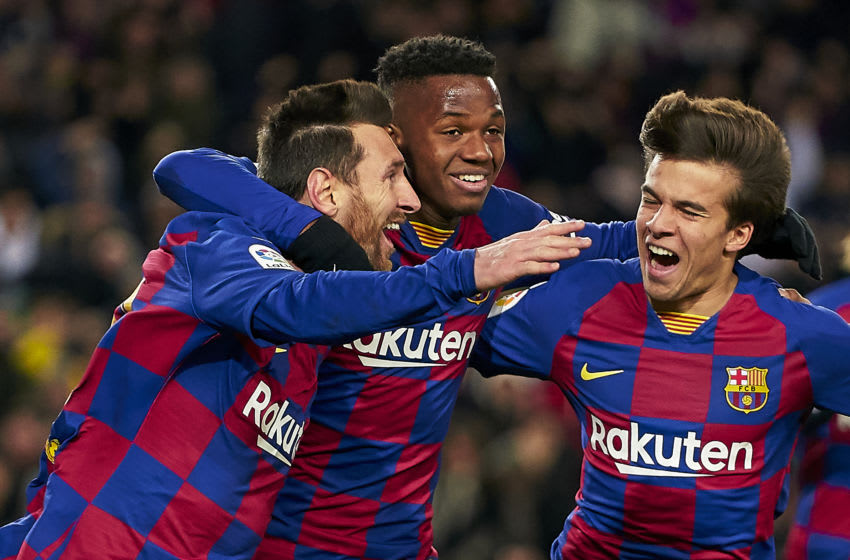 ionel Messi of Barcelona celebrates after scoring his team's first goal with his teammates Ansu Fati and Riqui Puig (Photo by Quality Sport Images/Getty Images)