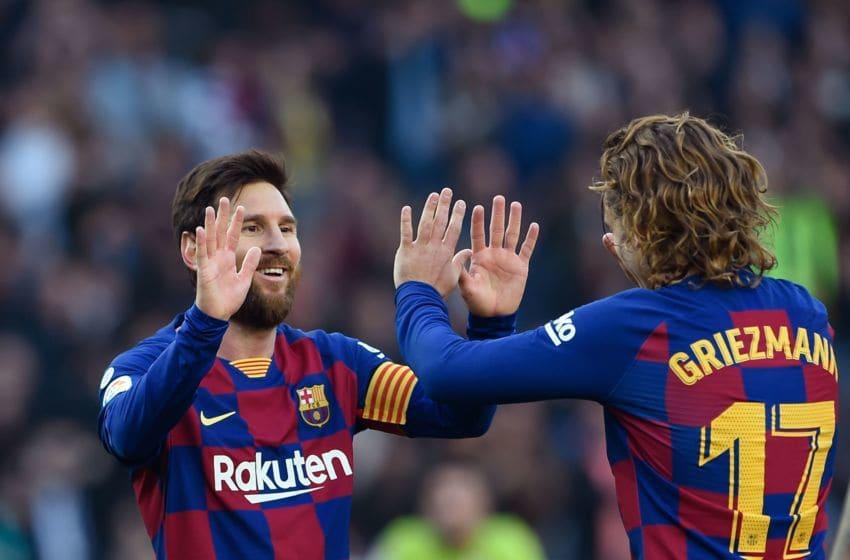 Barcelona's Argentine forward Lionel Messi (L) Antoine Griezmann(Photo by Josep LAGO / AFP) (Photo by JOSEP LAGO/AFP via Getty Images)