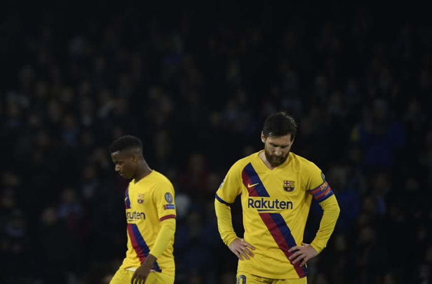 Barcelona's Argentine forward Lionel Messi (R) reacts after a draw in the UEFA Champions League round of 16 first-leg football match between SSC Napoli and FC Barcelona at the San Paolo Stadium in Naples on February 25, 2020. (Photo by Filippo MONTEFORTE / AFP) (Photo by FILIPPO MONTEFORTE/AFP via Getty Images)