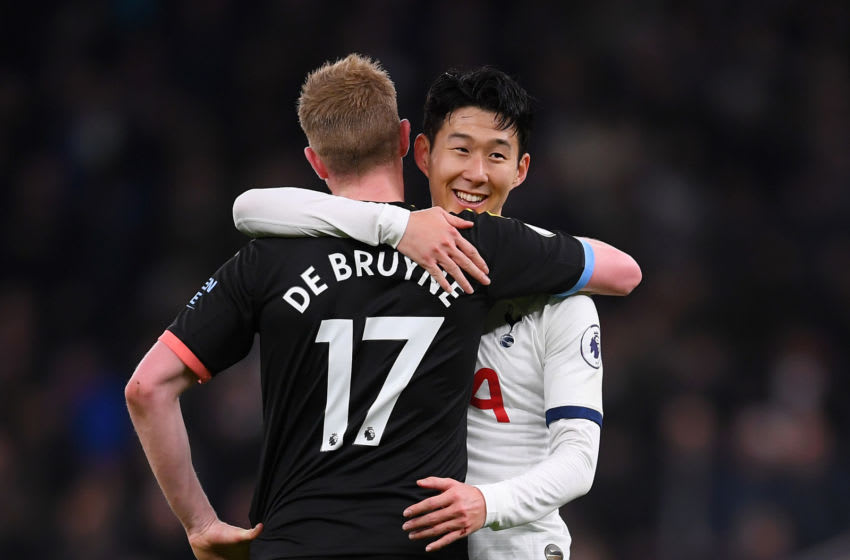 Heung-Min Son of Tottenham Hotspur consoles Kevin De Bruyne of Manchester City (Photo by Laurence Griffiths/Getty Images)