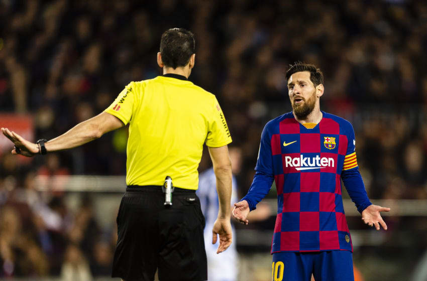 BARCELONA, SPAIN - MARCH 07: Lionel Messi of FC Barcelona (R) talks to FIFA Referee Juan Martinez Munuera (L) during the Liga match between FC Barcelona and Real Sociedad at Camp Nou on March 7, 2020 in Barcelona, Spain. (Photo by Eurasia Sport Images/Getty Images)