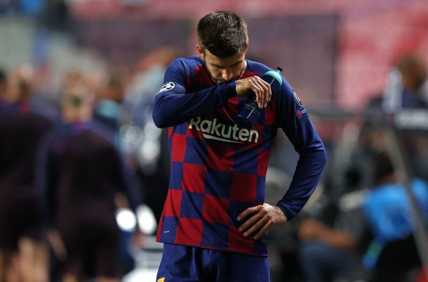 Barcelona's Gerard Pique reacts at the end of the match between Barcelona and Bayern Munich. (Photo by Rafael Marchante / POOL / AFP) (Photo by RAFAEL MARCHANTE/POOL/AFP via Getty Images)