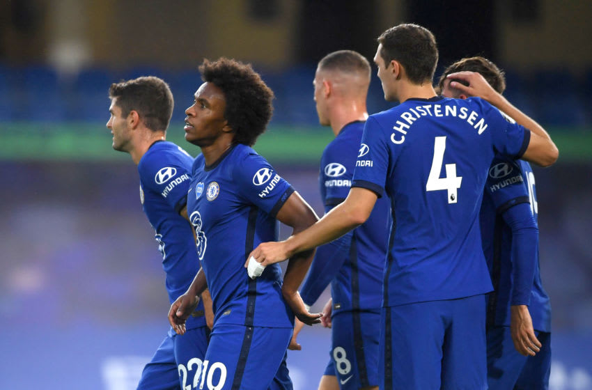 LONDON, ENGLAND - JULY 04: Willian of Chelsea celebrates with teammates after scoring his team's second goal during the Premier League match between Chelsea FC and Watford FC at Stamford Bridge on July 04, 2020 in London, England. Football Stadiums around Europe remain empty due to the Coronavirus Pandemic as Government social distancing laws prohibit fans inside venues resulting in all fixtures being played behind closed doors. (Photo by Mike Hewitt/Getty Images)