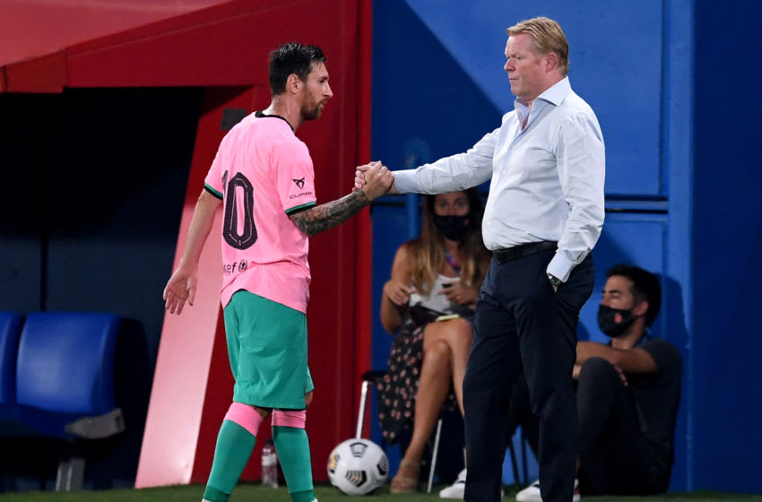 Ronald Koeman, Head Coach of FC Barcelona greets Lionel Messi of FC Barcelona (Photo by David Ramos/Getty Images)