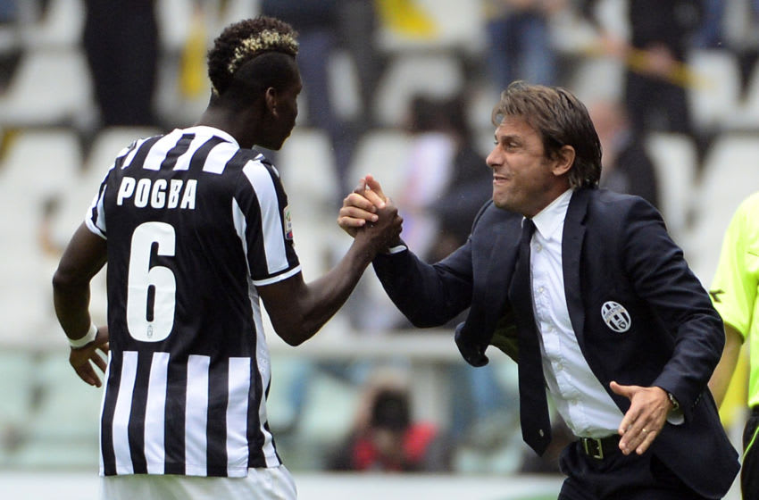 Juventus' French midfielder Paul Labile Pogba (L) celebrates with coach Antonio Conte after scoring during the Serie A football match Torino vs Juventus at the Olimpico stadium on September 29, 2013 in Turin. AFP PHOTO / OLIVIER MORIN (Photo credit should read OLIVIER MORIN/AFP via Getty Images)