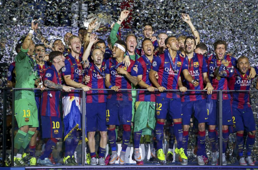 (L-R) goalkeeper Claudio Bravo of FC Barcelona, Munir El Haddadi of FC Barcelona, Lionel Messi of FC Barcelona, Martin Montoya of FC Barcelona, Ivan Rakitic of FC Barcelona, Luis Suarez of FC Barcelona, Andres Iniesta of FC Barcelona, Xavi Hernandez of FC Barcelona, Neymar of FC Barcelona, goalkeeper Marc-Andre ter Stegen of FC Barcelona, Marc Bartra of FC Barcelona, Adriano of FC Barcelona, Jeremy Mathieu of FC Barcelona, Rafinha of FC Barcelona, Sergio Busquets of FC Barcelona, Sergi Roberto of FC Barcelona, Dani Alves of FC Barcelona, with Champions League trophy during the UEFA Champions League final match between Barcelona and Juventus on June 6, 2015 at the Olympic stadium in Berlin, Germany.(Photo by VI Images via Getty Images)