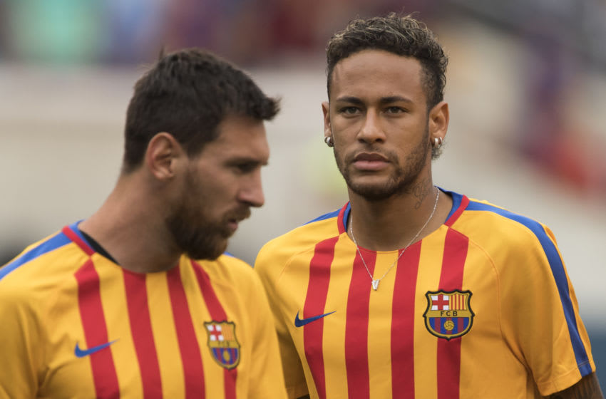 (FILES) This file photo taken on July 22, 2017 shows Neymar (R) and Lionel Messi (L) of FC Barcelona warming up before the International Champions Cup (ICC) match between Juventus FC and FC Barcelona at the Met Life Stadium in East Rutherford, New Jersey. One argument backing Neymar's decision to leave Barca on top of reportedly tripling his wages is to move out of Messi's shadow and compete to become the first Ballon d'Or winner outside of Messi and Ronaldo for a decade. / AFP PHOTO / DON EMMERT (Photo credit should read DON EMMERT/AFP via Getty Images)
