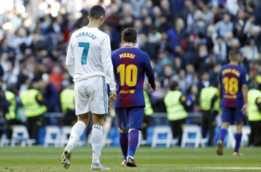 Cristiano Ronaldo of Real Madrid and Lionel Messi of Barcelona (Photo by TF-Images/TF-Images via Getty Images)