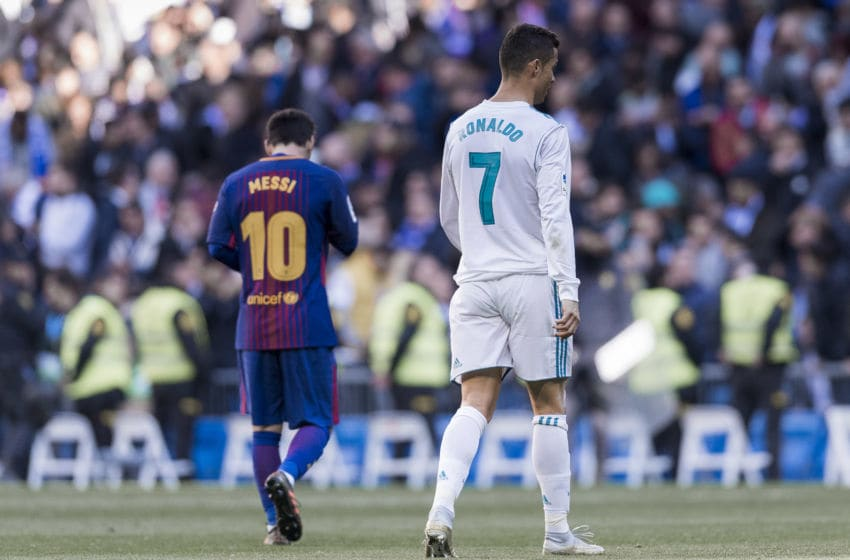 Lionel Messi of FC Barcelona and Cristiano Ronaldo of Real Madrid. (Photo by Power Sport Images/Getty Images)