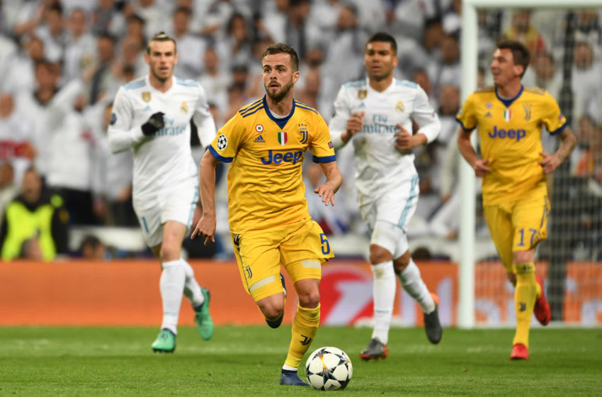Miralem Pjanic of Juventus in action during the UEFA Champions League quarter final second leg match between Real Madrid (Photo by Etsuo Hara/Getty Images)