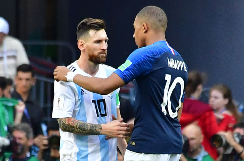 Argentina's forward Lionel Messi congratulates France's forward Kylian Mbappe (R) at the end of the Russia 2018 World Cup round of 16 football match between France and Argentina at the Kazan Arena in Kazan on June 30, 2018. (Photo by Luis Acosta / AFP) / RESTRICTED TO EDITORIAL USE - NO MOBILE PUSH ALERTS/DOWNLOADS (Photo credit should read LUIS ACOSTA/AFP via Getty Images)