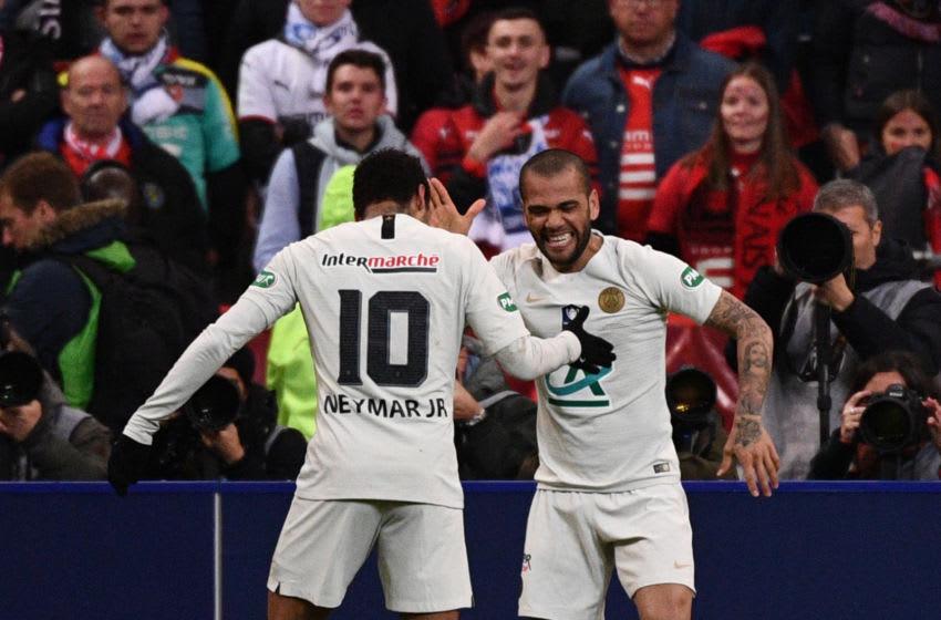 Dani Alves and Neymar. (Photo by Martin BUREAU / AFP) (Photo credit should read MARTIN BUREAU/AFP via Getty Images)