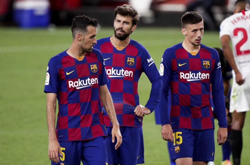 (L-R) Sergio Busquets of FC Barcelona, Gerard Pique of FC Barcelona, Clement Lenglet of FC Barcelona (Photo by David S. Bustamante/Soccrates/Getty Images)