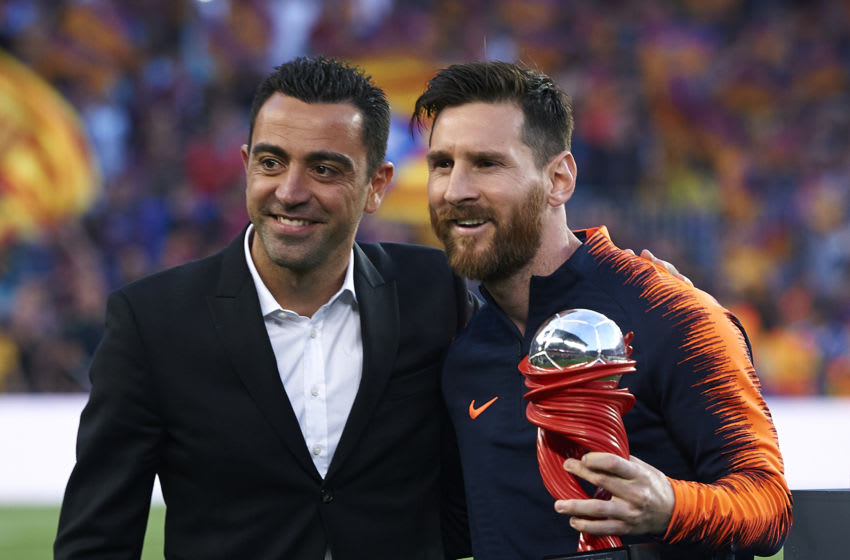 Xavi Hernandez gives Lionel Messi of Barcelona the trophy (Photo by Quality Sport Images/Getty Images)