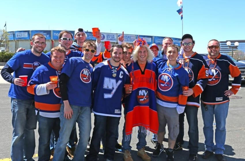 Apr 25, 2015; Uniondale, NY, USA; New York Islanders fans pose for a photo prior to the final Islanders game to be played in Nassau Coliseum game in six of the first round of the 2015 Stanley Cup Playoffs between the Washington Capitals and New York Islanders at Nassau Veterans Memorial Coliseum. Mandatory Credit: Andy Marlin-USA TODAY Sports