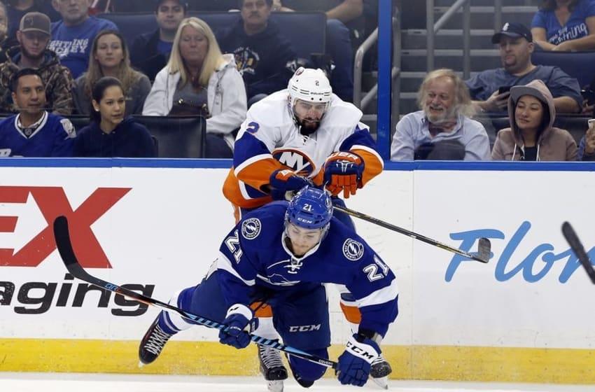 Nov 10, 2016; Tampa, FL, USA; New York Islanders defenseman Nick Leddy (2) defends Tampa Bay Lightning center Brayden Point (21) during the third period at Amalie Arena. Tampa Bay Lightning defeated the New York Islanders 4-1. Mandatory Credit: Kim Klement-USA TODAY Sports