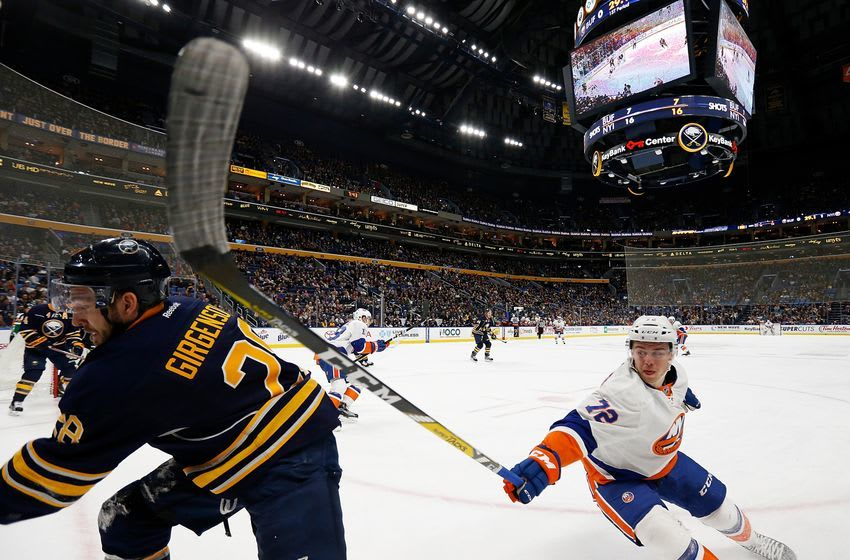 Dec 16, 2016; Buffalo, NY, USA; New York Islanders left wing Anthony Beauvillier (72) tries to slow down Buffalo Sabres center Zemgus Girgensons (28) during the first period at KeyBank Center. Mandatory Credit: Kevin Hoffman-USA TODAY Sports