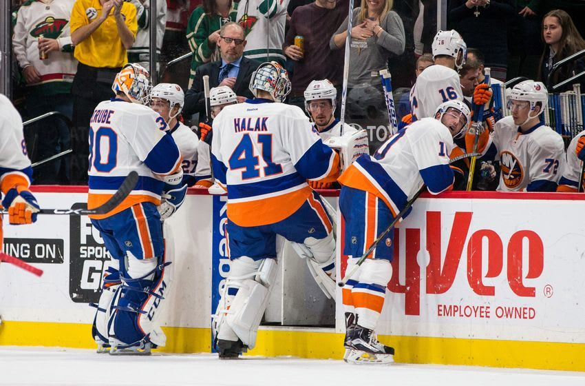 Dec 29, 2016; Saint Paul, MN, USA; New York Islanders goalie Jaroslav Halak (41) is pulled from the game in favor of goalie Jean-Francois Berube (30) during the second period against the Minnesota Wild at Xcel Energy Center. Mandatory Credit: Brace Hemmelgarn-USA TODAY Sports