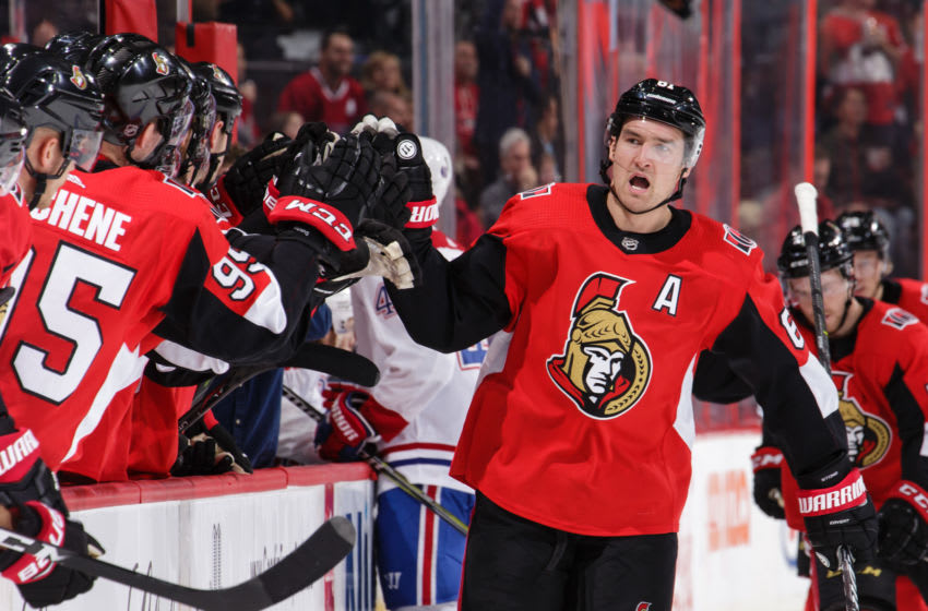 OTTAWA, ON - MARCH 20: Mark Stone #61 of the Ottawa Senators celebrates his first period goal against the Montreal Canadiens with team mates on the bench at Canadian Tire Centre on October 20, 2018 in Ottawa, Ontario, Canada. (Photo by Jana Chytilova/Freestyle Photography/Getty Images)