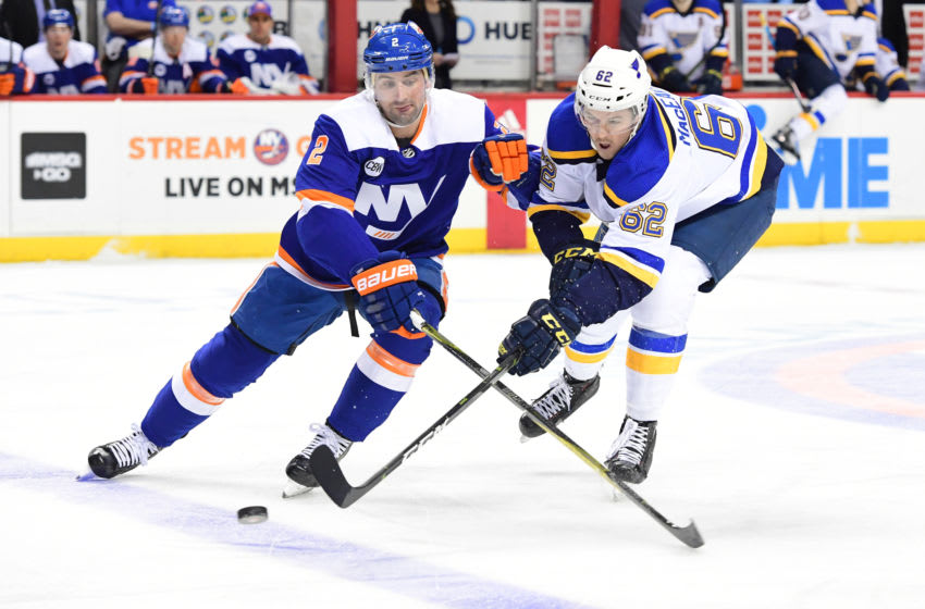 NEW YORK, NEW YORK - JANUARY 15: Nick Leddy #2 of the New York Islanders and Mackenzie MacEachern #62 of the St. Louis Blues battle for the puck during the first period of the game at Barclays Center on January 15, 2019 in the Brooklyn borough of New York City. (Photo by Sarah Stier/Getty Images)