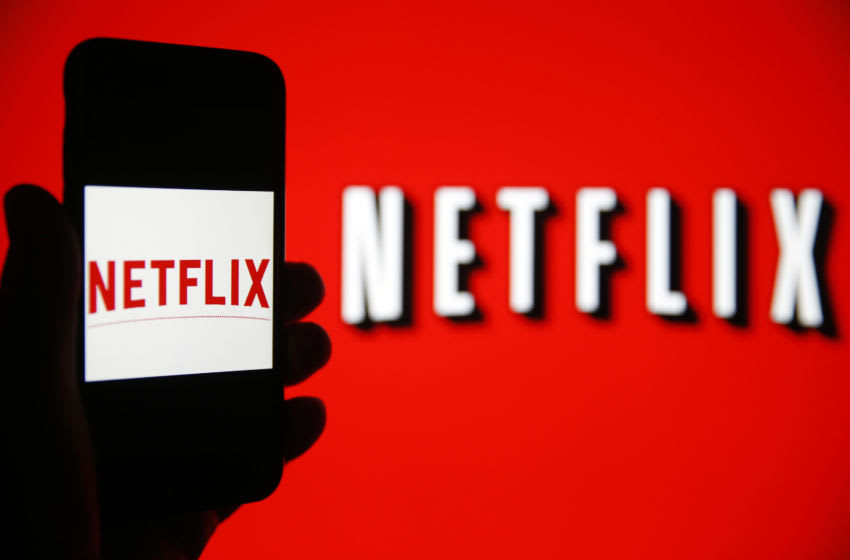 PARIS, FRANCE - FEBRUARY 13: In this photo iIllustration, the Netflix logo is seen on the screen of an iPhone in front of a computer screen showing a Netflix logo on February 13, 2019 in Paris, France. Netflix, the US giant of online video subscription, has more than 5 million subscribers in France, 4 and a half years after its arrival in France in September 2014, a spokesman for the company revealed on Wednesday. Netflix offers movies and TV series over the internet and now has 137 million subscribers worldwide. (Photo by Chesnot/Getty Images)