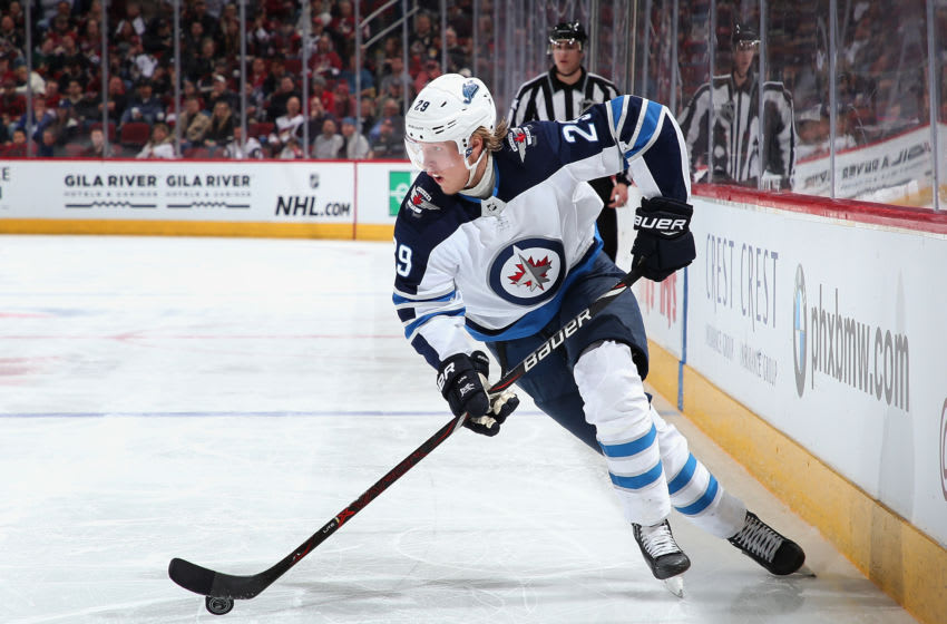 GLENDALE, ARIZONA - FEBRUARY 24: Patrik Laine #29 of the Winnipeg Jets skates with the puck during the third period of the NHL game against the Arizona Coyotes at Gila River Arena on February 24, 2019 in Glendale, Arizona. The Coyotes defeated the Jets 4-1. (Photo by Christian Petersen/Getty Images)