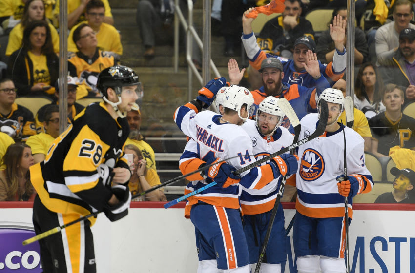 PITTSBURGH, PA - APRIL 16: Brock Nelson #29 of the New York Islanders celebrates with teammates after scoring a goal during the first period in Game Four of the Eastern Conference First Round against the Pittsburgh Penguins at PPG PAINTS Arena on April 16, 2019 in Pittsburgh, Pennsylvania. (Photo by Justin Berl/Getty Images)