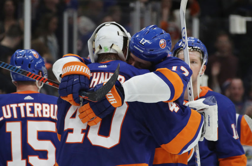 UNIONDALE, NEW YORK - MARCH 30: Robin Lehner #40 and Matt Martin #17 of the New York Islanders hug following a 5-1 victory over the Buffalo Sabres at NYCB Live's Nassau Coliseum on March 30, 2019 in Uniondale, New York. (Photo by Bruce Bennett/Getty Images)