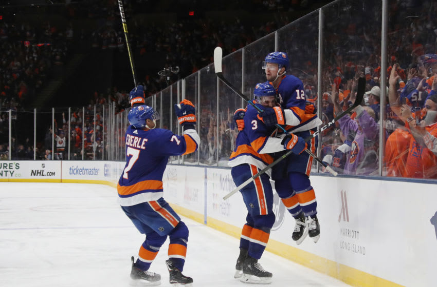 UNIONDALE, NEW YORK - APRIL 10: (l-r) Adam Pelech #3 and Josh Bailey #12 of the New York Islanders celebrate Bailey's game winning overtime goal against the Pittsburgh Penguins in Game One of the Eastern Conference First Round during the 2019 NHL Stanley Cup Playoffs at NYCB Live's Nassau Coliseum on April 10, 2019 in Uniondale, New York. The Islanders defeated the Penguins 4-3 in overtime. (Photo by Bruce Bennett/Getty Images)