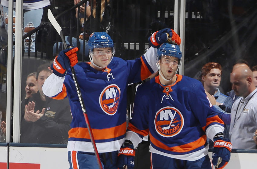 UNIONDALE, NEW YORK - SEPTEMBER 17: (L-R) Noah Dobson #45 and Derick Brassard #10 of the New York Islanders celebrate Brassard's third period goal against the Philadelphia Flyers at the Nassau Veterans Memorial Coliseum on September 17, 2019 in Uniondale, New York. The Islanders defeated the Flyers 3-2 in overtime. (Photo by Bruce Bennett/Getty Images)