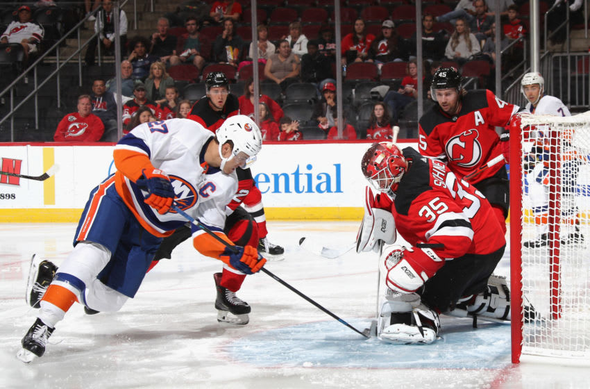 NEWARK, NEW JERSEY - SEPTEMBER 21: Anders Lee #27 of the New York Islanders moves in on Cory Schneider #35 of the New Jersey Devils at the Prudential Center on September 21, 2019 in Newark, New Jersey. The Devils defeated the Islanders 4-3. (Photo by Bruce Bennett/Getty Images)