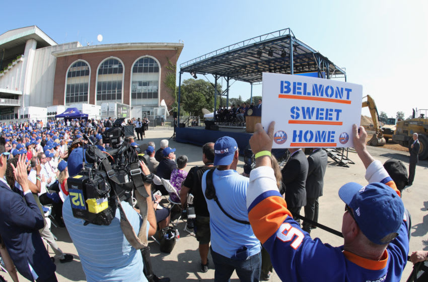 ELMONT, NEW YORK - SEPTEMBER 23: Patrick Dowd holds up a sign at the groundbreaking ceremony for the New York Islanders hockey arena at Belmont Park on September 23, 2019 in Elmont, New York. The $1.3 billion facility, which will seat 19,000 and include shops, restaurants and a hotel, is expected to be completed in time for the 2021-2022 hockey season. (Photo by Bruce Bennett/Getty Images)