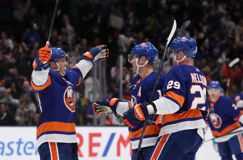 UNIONDALE, NEW YORK - OCTOBER 24: Josh Bailey #12 of the New York Islanders celebrates his second period goal with Anthony Beauvillier #18, and Brock Nelson #29 against the Arizona Coyotes during their game at NYCB Live's Nassau Coliseum on October 24, 2019 in Uniondale, New York. (Photo by Al Bello/Getty Images)